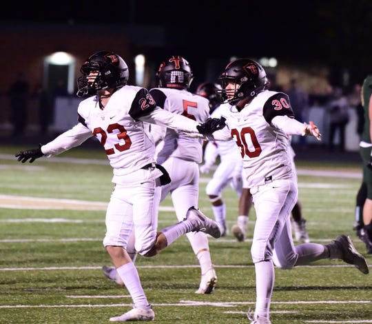 The Churchill special teams unit celebrates a missed field goal. Livonia Churchill beats Howell 27-0 on Oct. 25.