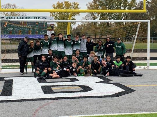 Novi celebrates its region four championship after it defeated Catholic Central 2-1.
