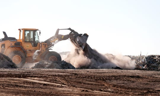 An employee combines drier dirt with a pile of wet dirt from a tunneling project before the soil is transported to processing at the Mecca Remediation Facility in Mecca, Calif., on Friday, October 25, 2019. MRF processes non-hazardous contaminated soil for reuse.