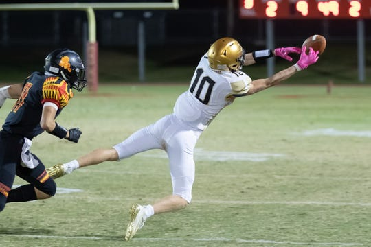Xavier Prep receiver Logan Peszko extends and almost makes a catch during a football game against Palm Desert on Oct. 25, 2019.