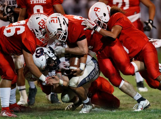 Palm Springs High School's players stop a  La Quinta High School play at Ralph Watts Stadium in Palm Springs on October 25, 2019.