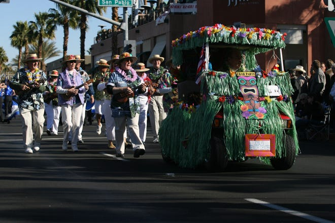 The Joslyn Senior Center golf cart makes its way along El Paseo in the Palm Desert Golf Cart Parade in January 2007. Ray Matlock Smythe emphasizes living with a purpose as the key to a happy retirement.