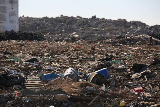 Some debris remains at the Mecca Remediation Facility in Mecca, Calif., on Friday, October 25, 2019. The previous operator failed to meet its obligation to clean up the site. The new operator has agreed to remove the trash.