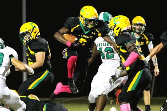 Catholic's Damarius McGhee jumps past defenders during Catholic's win Friday night against Choctaw