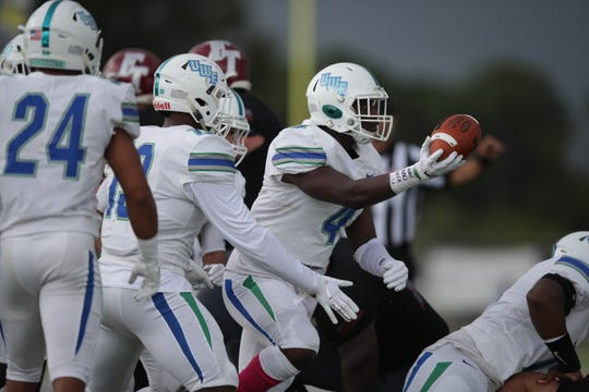 UWF redshirt freshman linebacker Gael Laurent celebrates a first-quarter turnover he secured against Florida Tech.