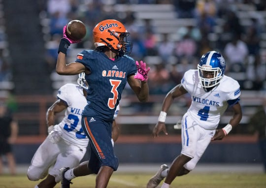 Chris Hale (3) throws for the 2-point conversion after a busted kick attempt as the Gators take a 50-7 lead during the Booker T. Washington vs. Escambia football game at Escambia High School in Pensacola on Friday, Oct. 25, 2019.