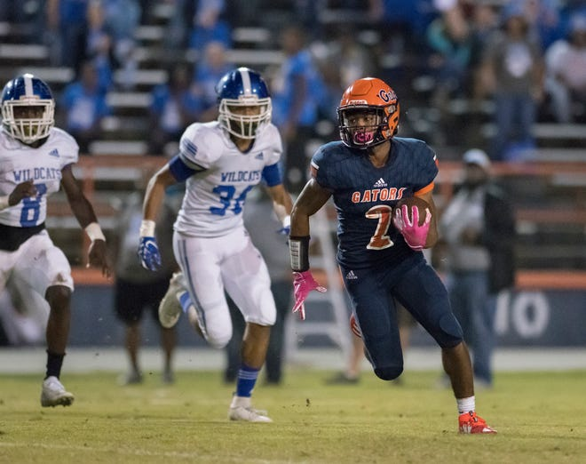Dt Gideon (2) reverses direction and returns a Wildcats punt for a touchdown and a 21-0 Gators lead (after adding the extra point) during the Booker T. Washington vs. Escambia football game at Escambia High School in Pensacola on Friday, Oct. 25, 2019.
