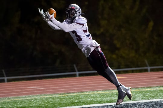 New Oxford's Abdul Janneh hauls in a pass in the end zone to score a touchdown late in the second quarter against Northeastern in a YAIAA Division I football game in Manchester on Friday, Oct. 25, 2019.