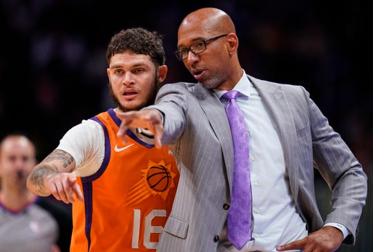 Phoenix Suns head coach Monty Williams talks with Tyler Johnson (16) against the Denver Nuggets during an NBA basketball game, Friday, Oct. 25, 2019, in Denver. (AP Photo/Jack Dempsey)