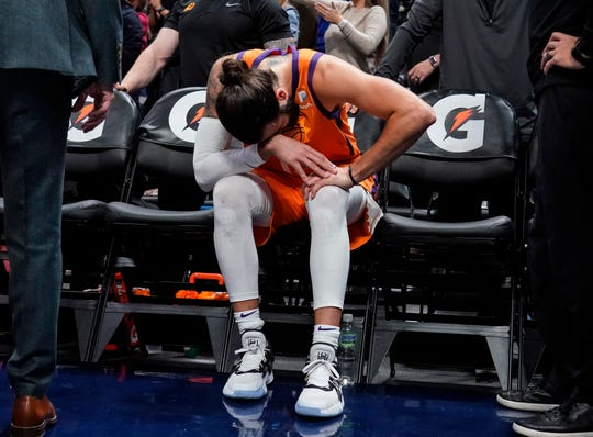 Phoenix Suns guard Ricky Rubio hangs his head after leaving the game with an injured knee during overtime in the team's NBA basketball game against the Denver Nuggets, Friday, Oct. 25, 2019, in Denver. Denver won 108-107. (AP Photo/Jack Dempsey)