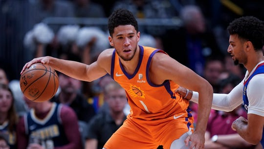 Phoenix Suns guard Devin Booker moves against the Denver Nuggets during the second quarter of an NBA basketball game, Friday, Oct. 25, 2019, in Denver. (AP Photo/Jack Dempsey)