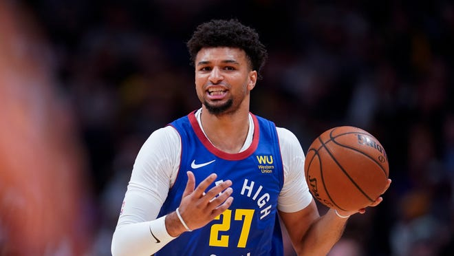Denver Nuggets guard Jamal Murray moves the ball up court against the Phoenix Suns during the first quarter of an NBA basketball game, Friday, Oct. 25, 2019, in Denver. (AP Photo/Jack Dempsey)