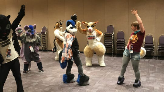 Samantha Shepler leads her Zumba class at the Arizona Fur Con in Mesa on Saturday, Oct. 26, 2019.