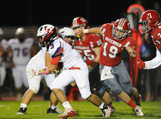 Lebanon's Joseph Mejias Rios (3) takes off up the middle on a 32 yard touchdown run during the second quarter.