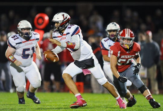 Lebanon quarterback Isaiah Rodriguez rolls out of the pocket during second quarter action against Annville-Cleona last week.