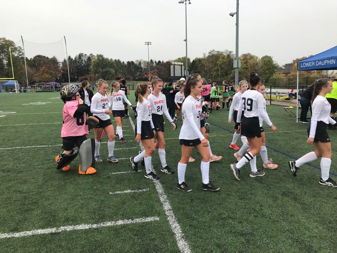 A happy group of Palmyra field hockey players exit the field after defeating rival Donegal 4-0 in the 2A district quarterfinals Saturday afternoon at Lower Dauphin Middle School.