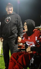 Steven Colledge shares a laugh with assistant coach Frank Hetrick on Senior Night at Annville-Cleona.