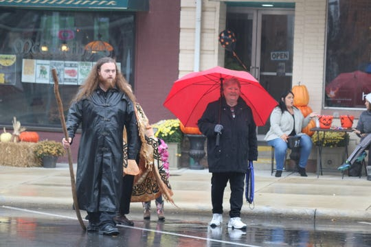 Families braved the rain and donned their costumes for an afternoon of trick-or-treating in downtown Port Clinton on Saturday.