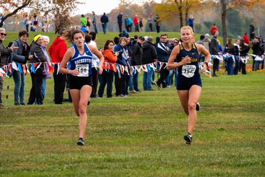 Port Huron Northern's Kiera Snyder (152) nears the finish line as she competes in the MHSAA Division 1 Girls Cross Country Regionals Saturday, Oct. 26, 2019, at Goodells County Park.