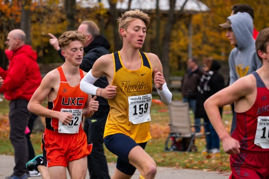 Port Huron Northern senior Carter Stoner (159) competes in the MHSAA Division 1 Boys Cross Country Regionals Saturday, Oct. 26, 2019, at Goodells County Park.