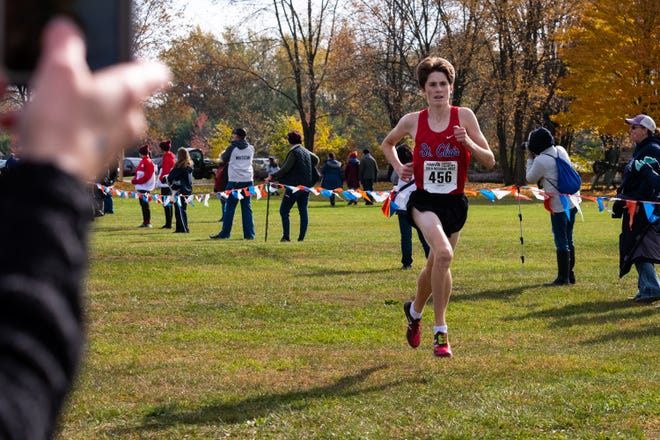 St. Clair junior Jack Pennewell nears the finish line as he competes in the MHSAA Division 2 Boys Cross Country Regionals Saturday, Oct. 26, 2019, at Goodells County Park.