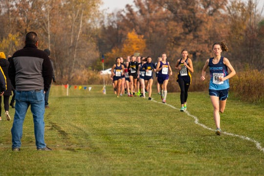 Richmond High School senior Maddy Bean leads the pack as runners  compete in the MHSAA Division 3 Girls Cross Country Regional race Saturday, Oct. 26, 2019, at Goodells County Park.