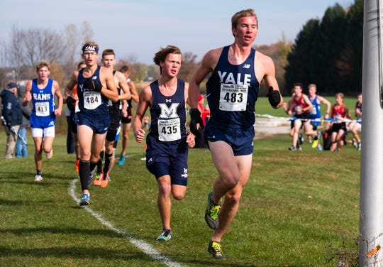 Yale's Matthew McClelland (483) leads a pack of runners as they compete in the MHSAA Division 2 Boys Cross Country Regionals Saturday, Oct. 26, 2019, at Goodells County Park.