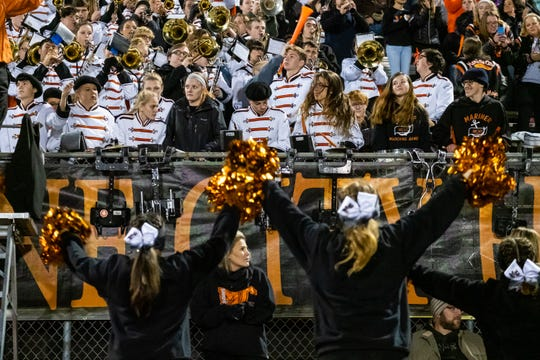 The Marine City High School cheerleaders cheer along with the marching band during their game against Warren Lincoln Friday, Oct. 25, 2019, at East China Stadium.