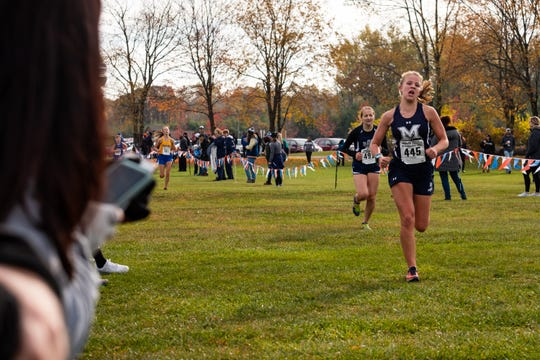 Marysville junior Linda Smyth approaches the finish line while competing in the MHSAA Division 2 Girls Cross Country Regionals Saturday, Oct. 26 2019, at Goodells County Park.