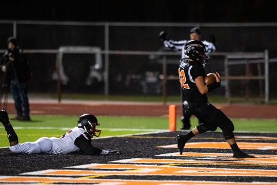 Marine City running back Aren Sopfe runs the football into the end zone for a touchdown in the second quarter of their game against Warren Lincoln Friday, Oct. 25, 2019, at East China Stadium.