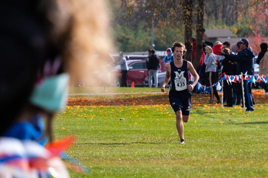 Marysville's Bryson Denuyl approaches the finish line in first place in the MHSAA Division 2 Boys Cross Country Regionals Saturday, Oct. 26, 2019, at Goodells County Park.