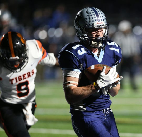 John Jay's Michael Blanchard Catches a  pass in White Plains' end zone to score the first touchdown of the game as Elijah Pierre covers him during Friday's game on October 25, 2019.