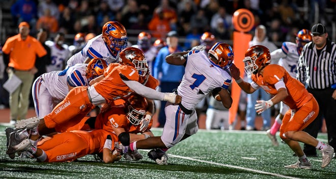 York High's Tyrell Whitt is tackled by a host of Central York defenders, Friday October 25, 2019.John A. Pavoncello photo