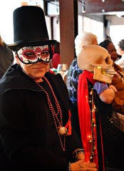 Tanya Cohen, of West York Borough, is dressed as Marie Laveau, a Louisiana Creole practitioner of Voodoo, during the Costume & Cocktail Crawl at The Handsome Cab in York City, Saturday, Oct. 26, 2019. The Dawn J. Sagert photo