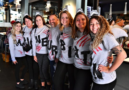 From left, Kaitlyn Rader, of Millersville, Lisa Keller, of Hellam Township, Victoria Keller, of Hallam Borough, Mark Keller, of Hellam Township, Taryn Keller of Wrightsville, Tristyn Keller, of Hellam Township, and Alecia Lewis, of Felton, dress as Shark Week during the Costume & Cocktail Crawl at The Left Bank in York City, Saturday, Oct. 26, 2019. The event, which includes stops at seven participating restaurants, focuses on bringing business to downtown York. The Dawn J. Sagert photo