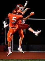 Kai'ryn Brown, left, and Beau Pribula celebrate after Pribula scored the Panthers' first touchdown against York High, Friday October 25, 2019.