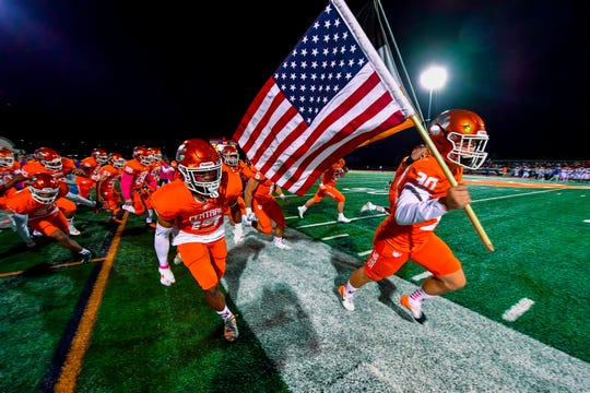 The Central York team charges onto the field for Friday's game vs. York High. Central is the No. 5 seed in the District 3 Class 6-A playoffs.
