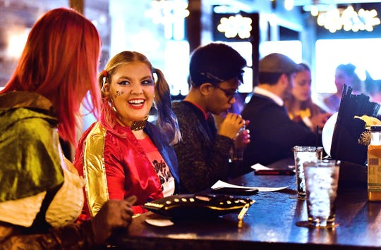From left, Sasha Mejias, of York City, and Amy Stermer and Nadia Young, both of York Township, make a stop at Rockfish Public House during the Costume & Cocktail Crawl in downtown York City, Saturday, Oct. 26, 2019. The event, which includes stops at seven participating restaurants, focuses on bringing business to downtown York. The Dawn J. Sagert photo