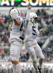 Oct 26, 2019; East Lansing, MI, USA; Penn State Nittany Lions tight end Pat Freiermuth (87) and wide receiver Jahan Dotson (5) celebrate a touchdown during the first quarter of a game against the Michigan State Spartans at Spartan Stadium. Mandatory Credit: Mike Carter-USA TODAY Sports