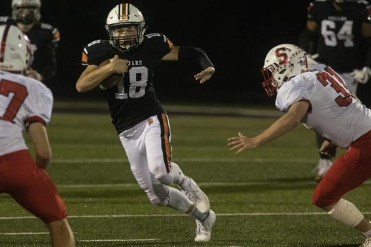 York Suburban quarterback Cam Brewer, center, runs the ball. York Suburban defeats Susquehannock 41-14 in football at York Suburban High School in Spring Garden Township, Friday, October 25, 2019.