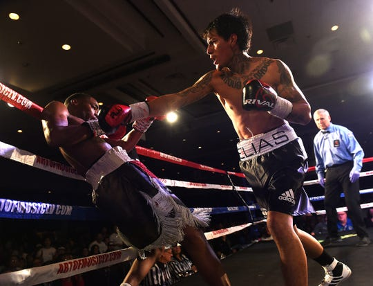 Peter Cortez, right, goes on the attack against Daquan Mays during the inaugural RJJ Boxing event at the Silver Legacy in Reno on Oct. 25, 2019.