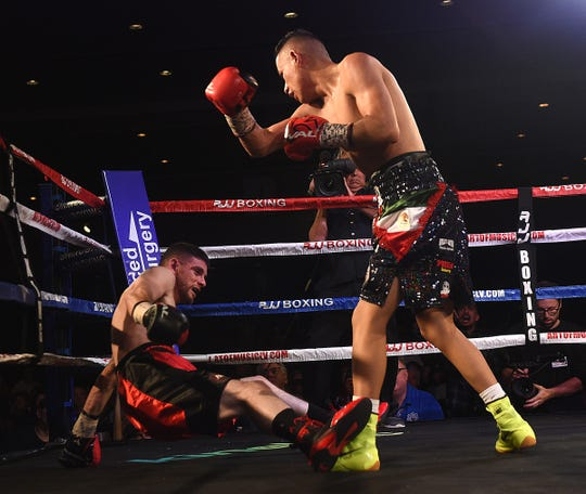 Ricardo Lucio, right, knocks down Mobley Villegas during the inaugural RJJ Boxing event at the Silver Legacy in Reno on Oct. 25, 2019.