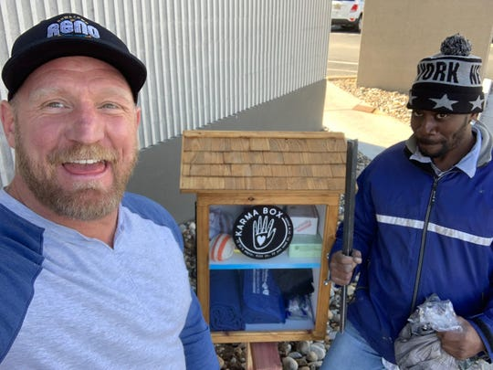 Grant Denton takes a selfie with his colleague, an ambassador for the Downtown Reno Partnership, Roderick Hamilton, at one of the Karma Boxes installed in the Reno area.