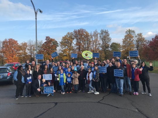 A group of about three dozen Democrats gathered in Penfield for the first day of early voting in the state of New York.
