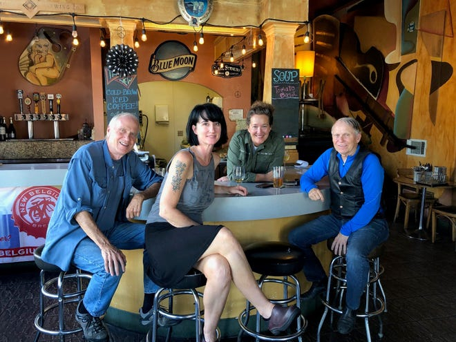 At Carnegie's restaurant and pub late one afternoon last week—Dwight Woods, left, server Keli Tims, owner Juli Heleniak and Bill Woods.