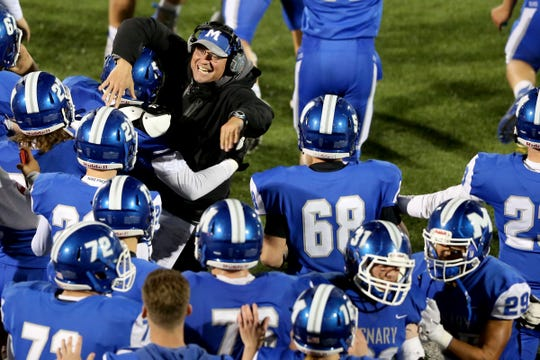 McNary head coach Jeff Auvinen celebrates with his team following the West Salem vs. McNary football game at McNary High School in Keizer on Oct. 25, 2019. McNary won the game 27-23.