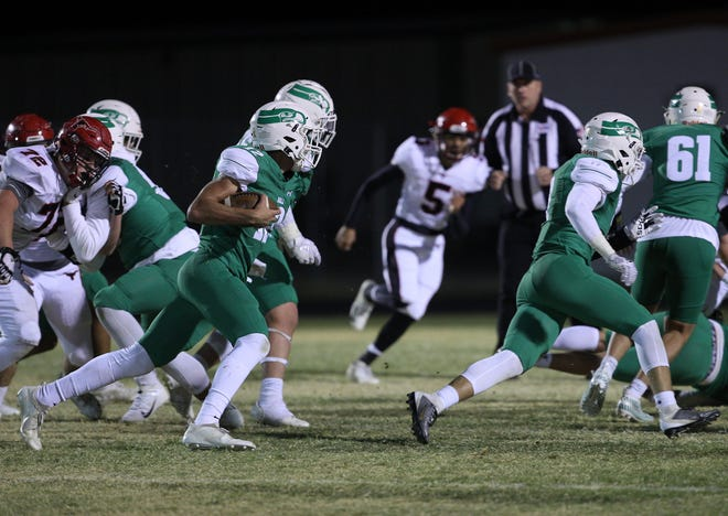 Drew Morrison rushes the ball for Wall on Friday, Oct. 25, 2019.