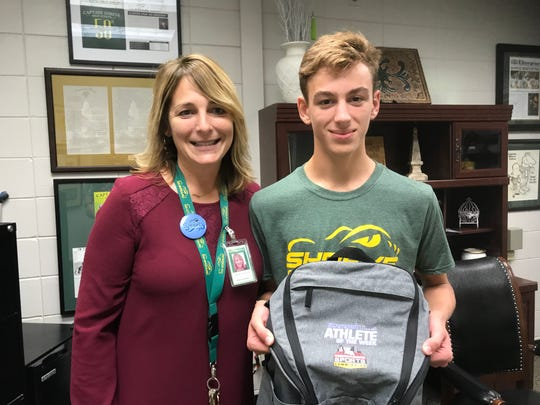 Captain Shreve principal Ginger Gustavson with cross country runner and Times/SBSC Athlete of the Week Alex Adcock.