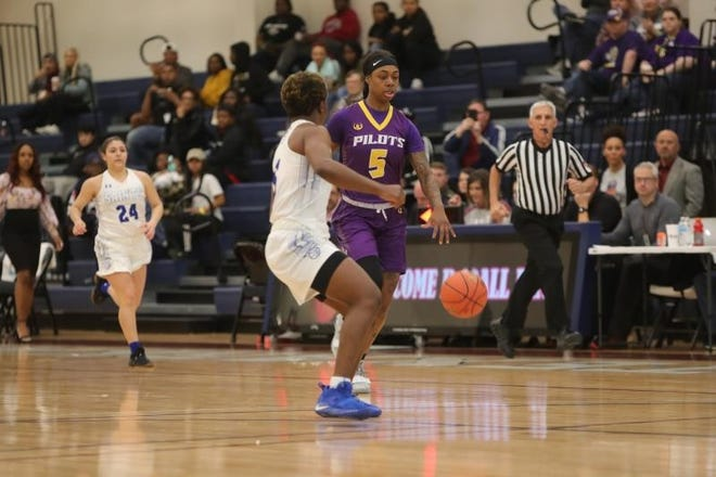 LSUS guard Sabrina Banks drives to the bucket in a game last season.