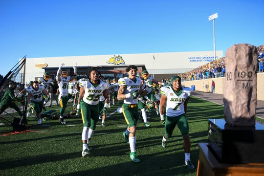 NDSU celebrates a win against the Jacks after the Dakota Marker game on Saturday, Oct. 26, 2019 at Dana J. Dykhouse Stadium in Brookings, S.D. The final score of the game was 23-16.